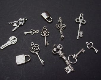 12 key & lock charms silver color.