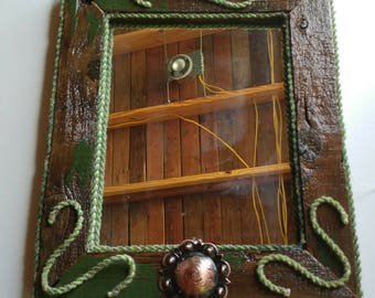 Mirror made from old fence wood from a set of Corrales in Friant Ca . over 70 yrs old unique piece with a western flare