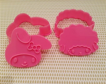 2 cookie cutters for cookies or cut in other blocks