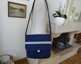 Leaning heavily toward the blue Royal Navy blue canvas guttee shoulder bag