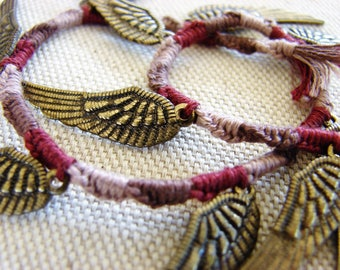 Burgundy coloured, woven bookmark, with kaki/bronze coloured metallic wings