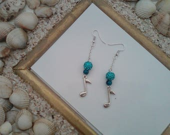 pair of earrings pearls and music notes