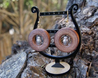 Hand turned earrings in textured Sipo wood