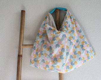 Reversible bag with turquoise handle
