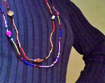 A pair of necklaces colorful without clasps.