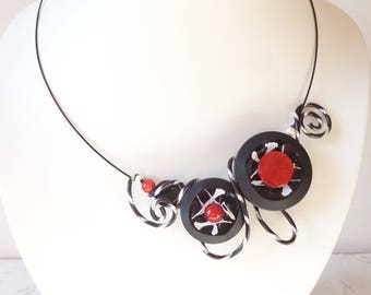 Necklace made of buttons, red, black and white.