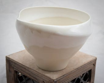 Altered white and cream spiral bowl