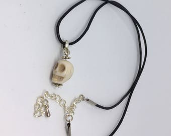 Ivory coloured skull pendant on a black cord Handmade