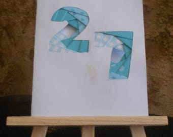 Birthday card with a number of customizable iris folding