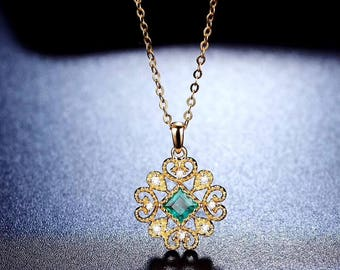 Exclusive beautiful necklace pendant Au 750 (18kt.) gold with emerald 0.16ct. and diamond 0.036ct.