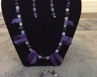 Absolutely Amethyst Necklace features 10 1 inch Amethyst pendants, faceted 14mm Amethyst beads, 8mm Amethyst rounds, and 8mm Quartz