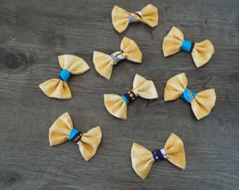 set of eight cotton fabric bows and the wax