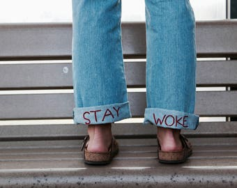 "Hand Embroidered ""Stay Woke"" Distressed Boyfriend Jeans"