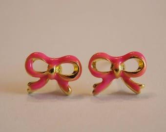 Pair of stud earrings modern enameled metal rose gold bow
