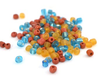 10 gr large blue, yellow and orange seed beads red glass 4mm / MPERRO014