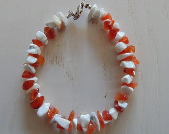 a bracelet made of two kinds of stones gems.