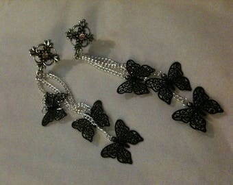 Butterflies, three butterflies hanging from a chain earrings