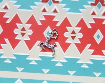 The silver colored deer or reindeer charm