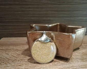 Gold round pendant