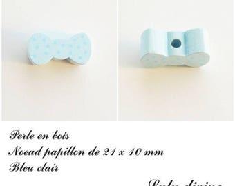 Wood 21 x 10 mm bead, Pearl flat bow tie: light blue