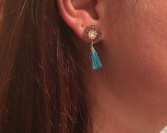 Print and turquoise tassel earrings in golden metal