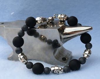 Small silver skull with black and gray bead bracelet with a magnetic clasp