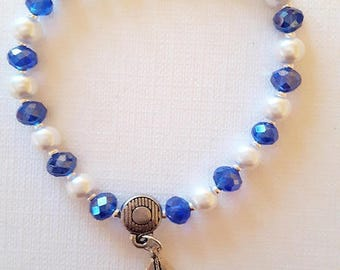 Bracelet white pearls blue and boat