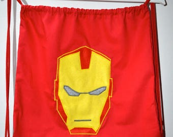 Red backpack with Iron Man mask