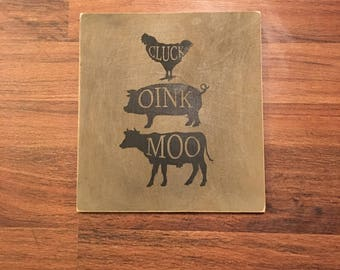 Cluck Oink Moo sign