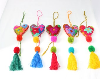 Hand stitched yarn multiuse decorative charms with stuffed heart, pompon and tassel.