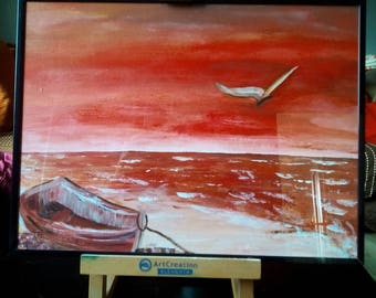 Acrylic painting of a sea landscape in shades of red with a black frame
