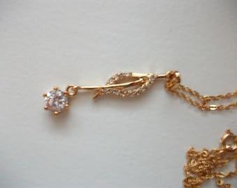 Necklace in 14 k diamond and rhinestone.