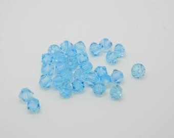 31 x 4mm (l504) aquamarine swarovski crystal bicone
