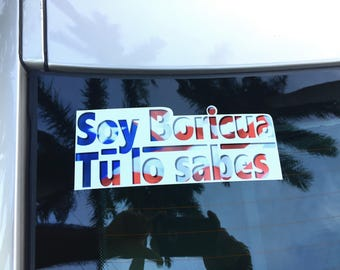 """Sticker depicting a stylized Puertorrican flag and the message: """"Soy Boricua, Tu lo sabes""""."""