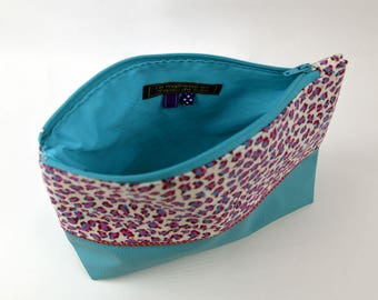 Toiletry bag or makeup turquoise and purple.