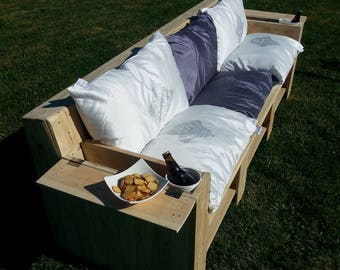 Wooden pallets with throw pillows sofa