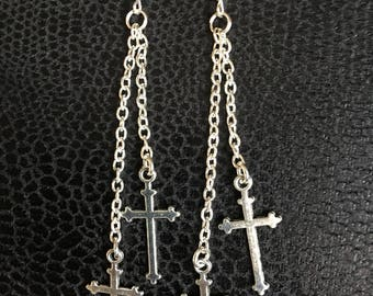 Gothic cross drop earrings.