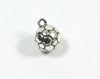 A silver football pendant charm