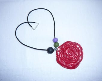 Very simple necklace with red rose and polymer beads mounted on a cord