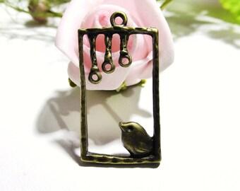 Bird on perch in metal bronze 4 connectors 35 x 19 mm