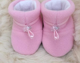Warm pink fleece child's slipper, booties, soft sole shoe from Toggle Toes in preshool size 24-36  months, child's shoe size 7-8