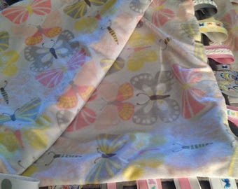 Butterfly themed tag ribbon blanket, one that is extremely soft and silky.  Perfect for a older child to cuddle with or a floor blanket.