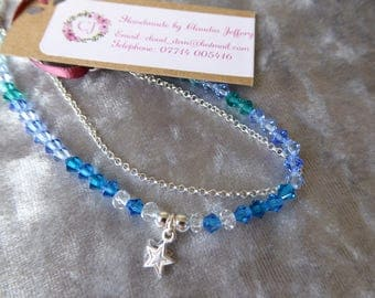 Sterling silver star charm and blue glass bracelet