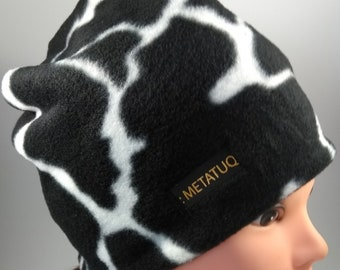 Reversible, pattern cow on one side, the other tiger patterned Hat