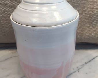 Pink and white cover container.