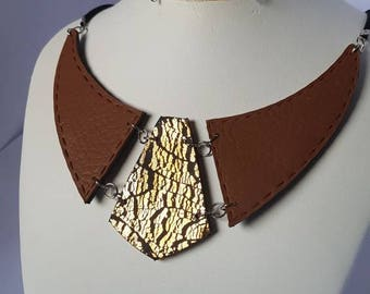 Gold bib necklace and leather