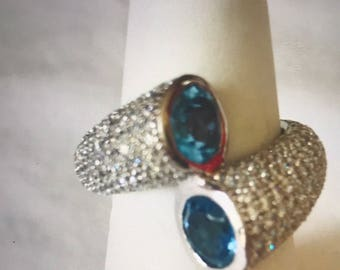 Sterling silver ring with cubic zirconia and blue topaz