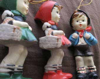 Vintage Hummel style plastic 1 boy and 2 girls ornaments