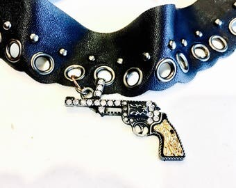 Faux leather choker necklace with fuax crystal, and metal gun charm