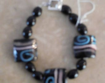 Black braclet with onyx beads and pillow beads